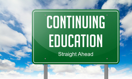 Highway Signpost with Continuing Education wording on Sky Background. photo