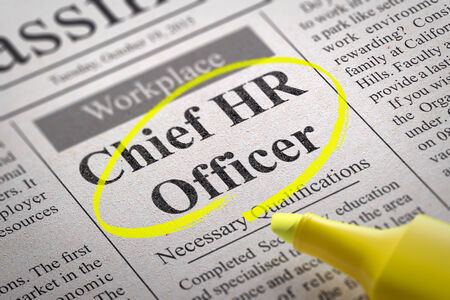 Chief HR Officer Vacancy in Newspaper. Job Search Concept. photo