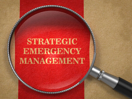 Strategic Emergency Management through Magnifying Glass on Old Paper with Red Vertical Line. photo