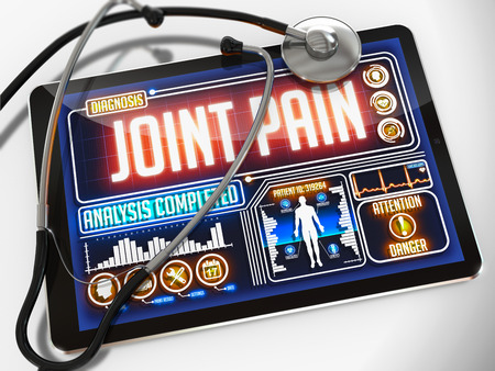 Medical Tablet with the Diagnosis of Joint Pain on the Display and a Black Stethoscope on White Background. photo