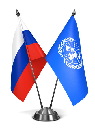 united nations: United Nations and Russia - Miniature Flags Isolated on White Background. Stock Photo