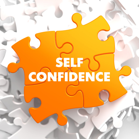 self confidence: Self Confidence on Yellow Puzzle on White Background. Stock Photo