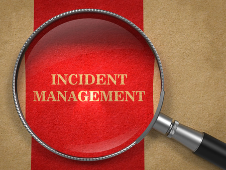 Incident Management through Magnifying Glass on Old Paper with Red Vertical Line. Stock Photo