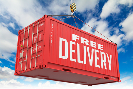 Free Delivery - Red Hanging Cargo Container on Sky Background. photo
