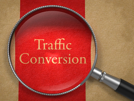 Traffic Conversion through Magnifying Glass on Old Paper with Red Vertical Line. photo