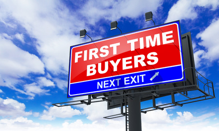 first time buyer: First Time Buyers - Red Billboard on Sky Background. Business Concept. Stock Photo