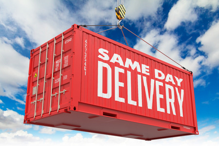 same: Same Day Delivery - Red Hanging Cargo Container on Sky Background.