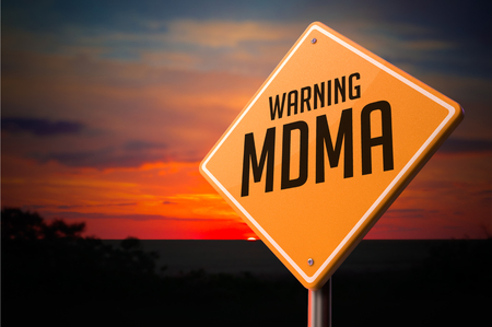 mdma: MDMA on Warning Road Sign on Sunset Sky Background.