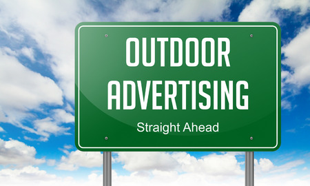 outdoor advertising: Highway Signpost with  Outdoor Advertising Wording on Sky Background.