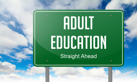 learning new skills: Highway Signpost with  Adult Education Wording on Sky Background.
