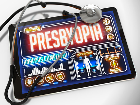 Medical Tablet with the Diagnosis of Presbyopia on the Display and a Black Stethoscope on White Background. photo
