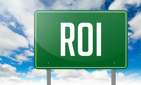coefficient: Highway Signpost with ROI wording on Sky Background. Stock Photo