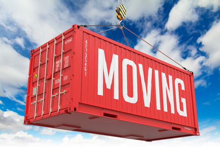 Moving - Red Hanging Cargo Container on Sky Background. photo