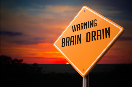 drains: Brain Drain on Warning Road Sign on Sunset Sky Background.