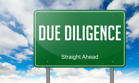 incorporation: Highway Signpost with Due Diligence wording on Sky Background. Stock Photo