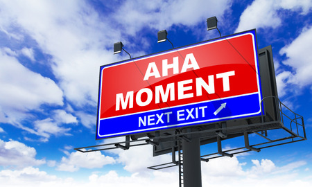 aha: Aha Moment - Red Billboard on Sky Background. Business Concept. Stock Photo