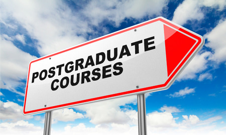 Postgraduate Courses on Red Road Sign on Sky Background. photo