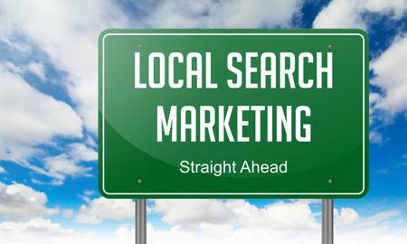 contextual: Carretera Poste indicador con Local redacci�n Search Marketing en el fondo del cielo, Foto de archivo