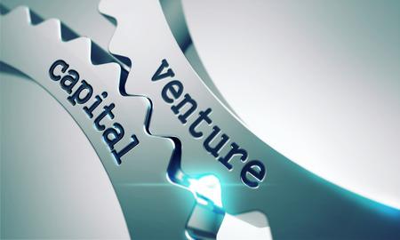 venture: Venture Capital Concept on the Mechanism of Metal Gears. Stock Photo