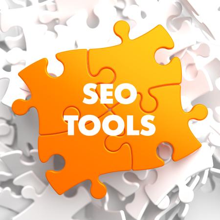Seo Tools on Orange Puzzle on White Background.