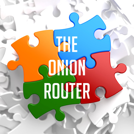 anonymity: The Onion Router on Variegated Puzzle on White Background.