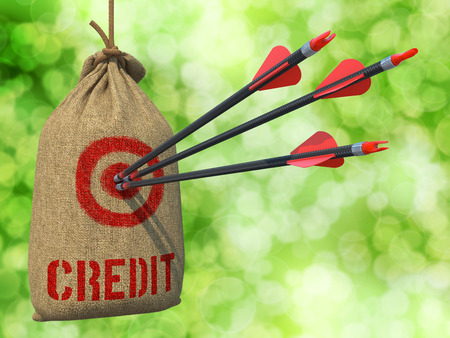 guarantor: Credit - Three Arrows Hit in Red Target on a Hanging Sack on Natural Bokeh Background.