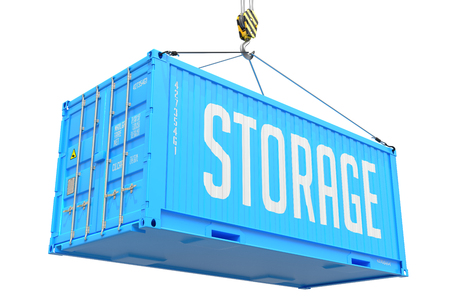 Storage - Blue Cargo Container hoisted by hook, Isolated on White Background. photo