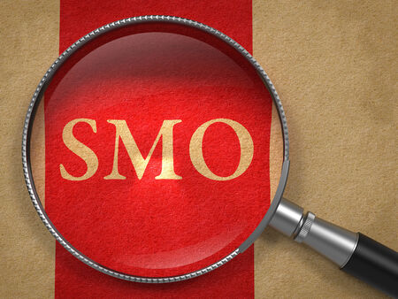 internet page site: SMO through Magnifying Glass on Old Paper with Red Vertical Line. Stock Photo