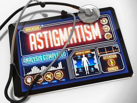 astigmatism: Astigmatism - Diagnosis on the Display of Medical Tablet and a Black Stethoscope on White Background.