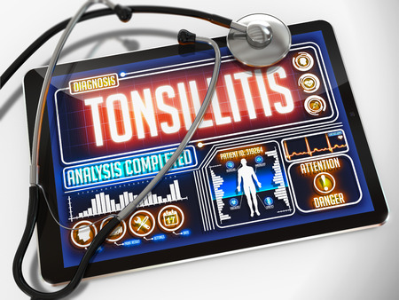 tonsillitis: Tonsillitis - Diagnosis on the Display of Medical Tablet and a Black Stethoscope on White Background.