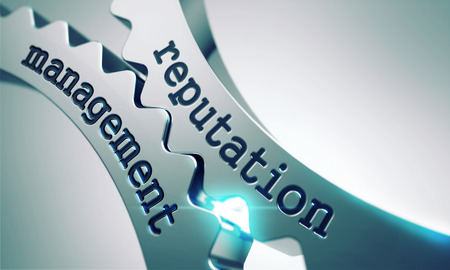 Reputation Management Concept on the Mechanism of Metal Cogwheels. Foto de archivo