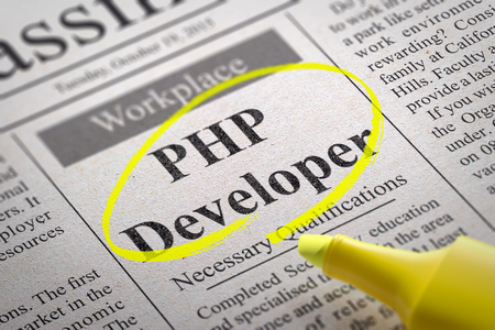 subversion: PHP Developer Vacancy in Newspaper. Job Seeking Concept. Stock Photo