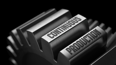 Continuous Production on the Metal Gears on Black Background. Stock Photo