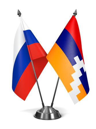 Russia and Nagorno-Karabakh of Miniature Flags Isolated on White Background. photo