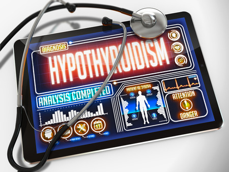 hypothyroidism: Hypothyroidism - Diagnosis on the Display of Medical Tablet and a Black Stethoscope on White Background. Stock Photo