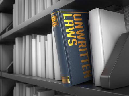 constraint: Unwritten Laws - Grey Book on the Black Bookshelf between white ones. Stock Photo