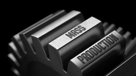 Mass Production on the Metal Gears on Black Background. photo