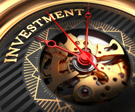 Investment on Black-Golden Watch Face with Watch Mechanism. Full Frame Closeup. Stock Photo