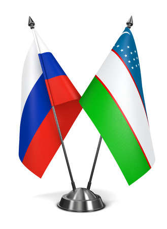 diplomatic: Russia and Uzbekistan - Miniature Flags Isolated on White Background.