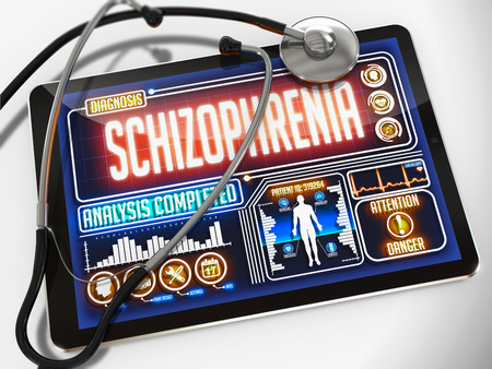 psychosocial: Schizophrenia - Diagnosis on the Display of Medical Tablet and a Black Stethoscope on White Background.
