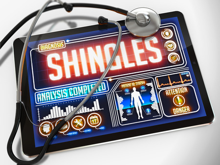 sores: Medical Tablet with the Diagnosis of Shingles on the Display and a Black Stethoscope on White Background.