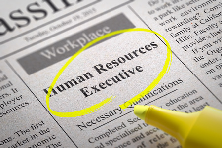 Human Resources Executive Vacancy in Newspaper. Job Search Concept. photo