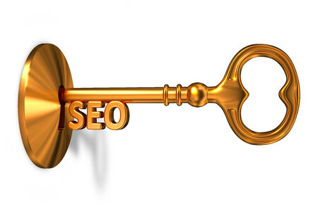 inserted: Seo - Golden Key is Inserted into the Keyhole Isolated on White Background Stock Photo