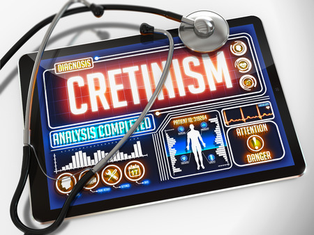 Cretinism - Diagnosis on the Display of Medical Tablet and a Black Stethoscope on White Background. Stock Photo
