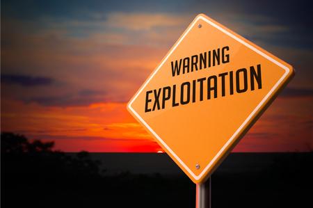exploitation: Exploitation on Warning Road Sign on Sunset Sky Background.