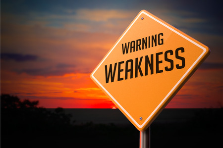Weakness on Warning Road Sign on Sunset Sky Background. Stock Photo