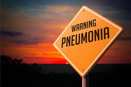 pharyngitis: Pneumonia on Warning Road Sign on Sunset Sky Background.