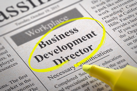 formalization: Business Development Director Vacancy in Newspaper. Job Search Concept. Stock Photo