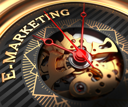 emarketing: E-Marketing on Black-Golden Watch Face with Closeup View of Watch Mechanism. Stock Photo