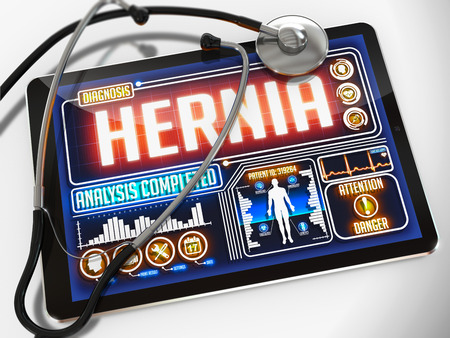 hernia: Hernia - Diagnosis on the Display of Medical Tablet and a Black Stethoscope on White Background.